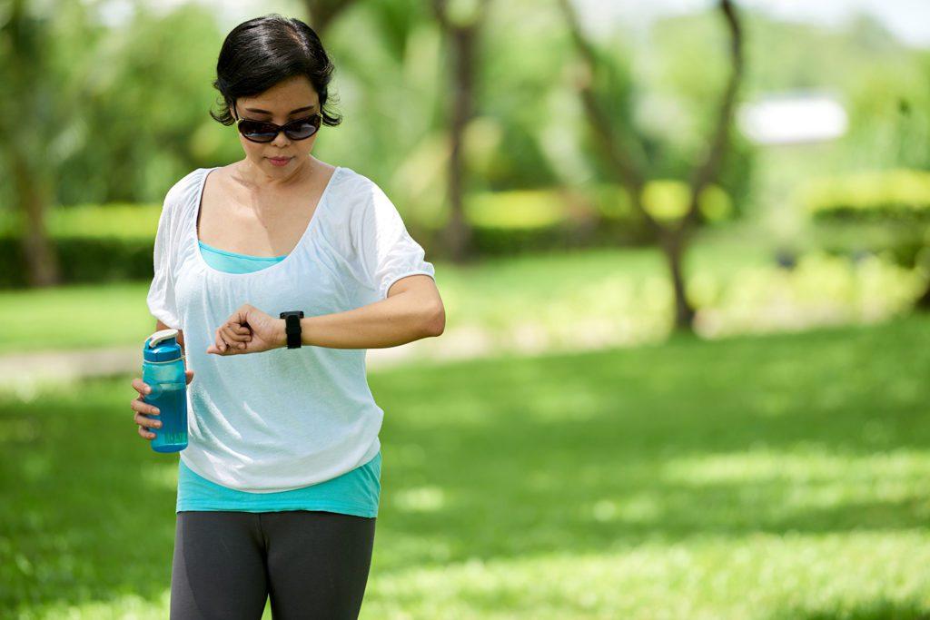 Woman Checking Fitness Wristband