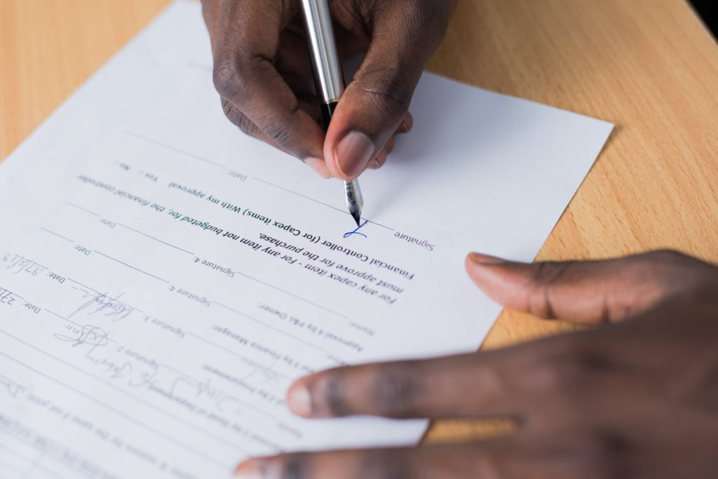 A person going through warranty paperwork, which is something you need to do when you buy your kitchen appliances abroad.