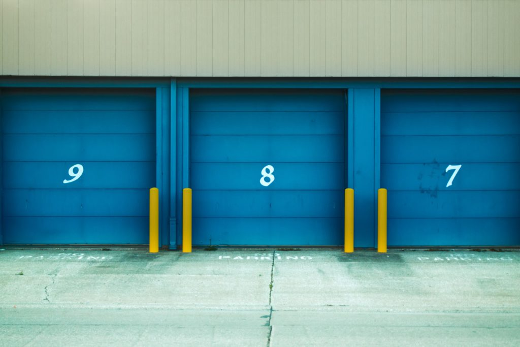 Three blue storage units with numbers on them