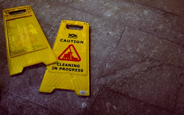 cleaning floors sign