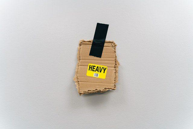 a cardboard piece saying heavy